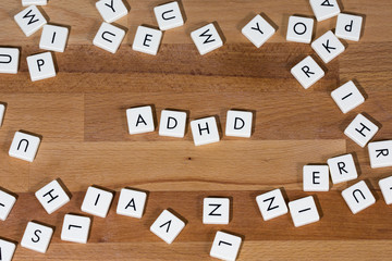 ADHD text on a wooden surface. Attention deficit hyperactivity disorder affects children and teens and can continue into adulthood. ADHD is the most commonly diagnosed mental disorder of children.