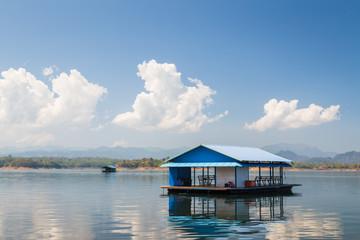 House in lake blue sky
