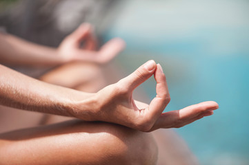 Close up Hand Gesture of Woman Doing an Outdoor Lotus Yoga Position. Close up. Blurred background