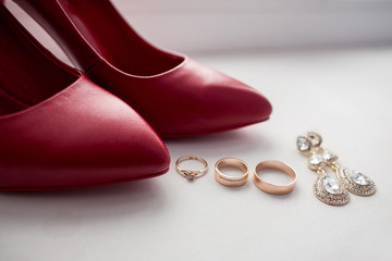 Wedding red shoes, wedding rings and bridal jewelry. Best wedding accessories
