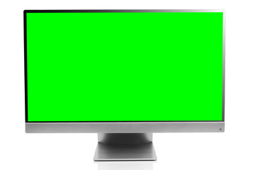 Sleek modern computer display with blank green chroma key screen, front view and isolated on white background with reflection