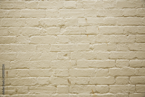A full page of cream painted brick wall background texture