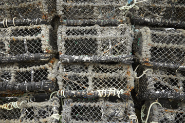 A whole page of stacked up lobster pots background texture