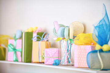 Closeup of colorful gifts box on shelf. Holyday decor