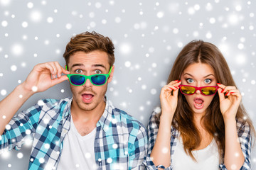 Surprised man and woman in glasses with open mouth on the backgr