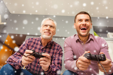 Two  handsome men playing video game on christmas holidays