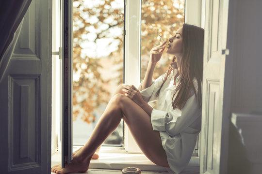 Pensive woman smoking