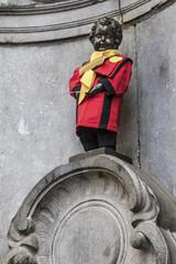 Manneken Pis dressed in costume of the National Brotherhood of the Bald of Belgium