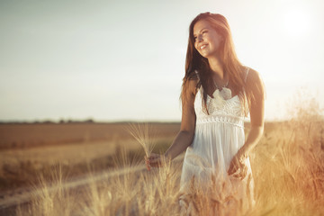Beautiful carefree woman in fields