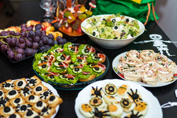 delicious sandwiches and snacks of various kinds on the table