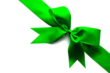 Green satin ribbon and bow isolated on white