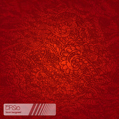 Seamless background made of paisley. Vivid orange and red.