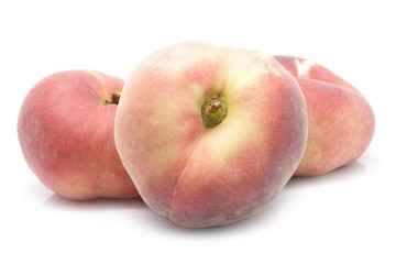chinese flat peaches on white background