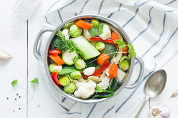 Colorful fresh clear spring soup - vegetarian stock