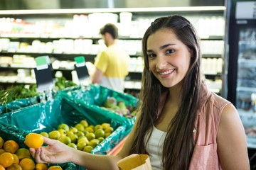 Woman shopping fresh fruit in supermarket