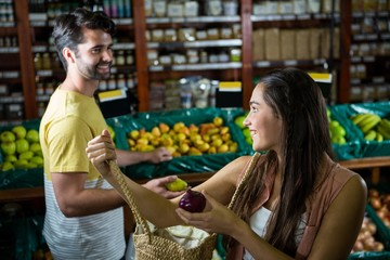 Smiling couple interacting with each other in organic section