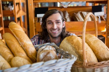 Man with a variety of breads