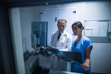 Doctor and nurse examining a x-ray
