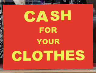 CASH FOR YOUR CLOTHES sign. Yellow on red. (Better than selling your blood.)