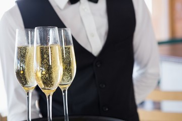 Waiter holding glasses of champagne