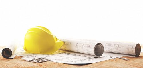 Elmetto giallo con progetti architetto per lavori in cantiere