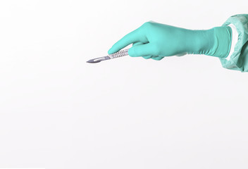 Surgeon hand witha scalpel