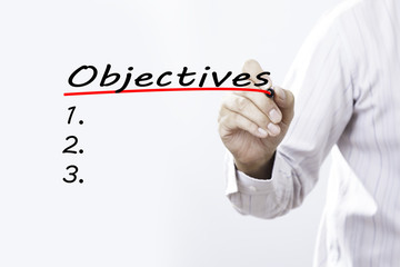 "Businessman hand writing inscription ""Objectives"" with marker, B"