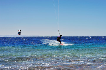 man riding on kite surf board on Red Sea, Dahab