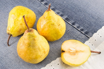 yellow pears on a pair of jeans