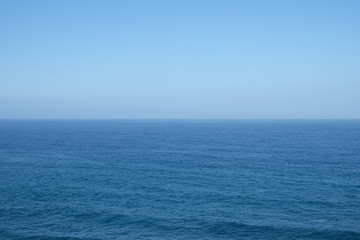 ocean horizon - clear blue sky background