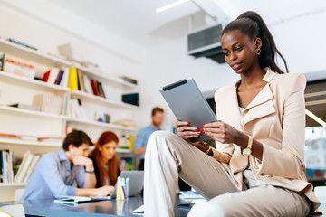 Businesswoman holding tablet in office
