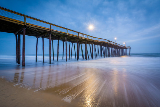 Waves in the Atlantic Ocean and the fishing pier at twilight, in