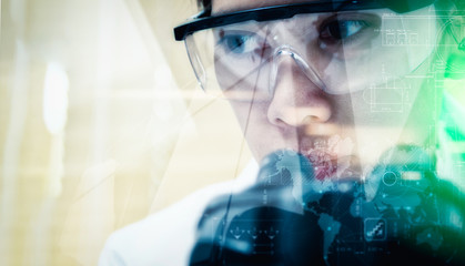 Double exposure of scientist with  microscope,equipment and scie