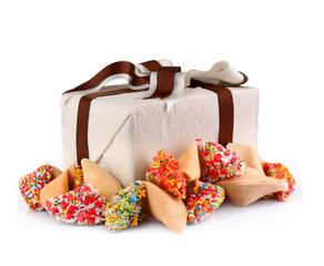 Pile of fortune cookies with sprinkles and present box isolated on white