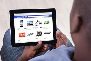 African Man Shopping Online On Digital Tablet