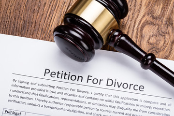 Wooden Gavel On Petition For Divorce Paper