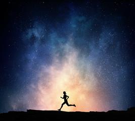 Jogger running at night . Mixed media