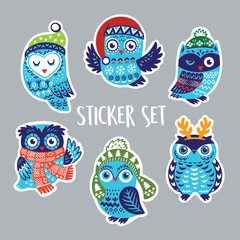 Set of stickers with Christmas owls in knitted hats, scarves