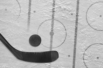 Black hockey stick and hockey field with markings