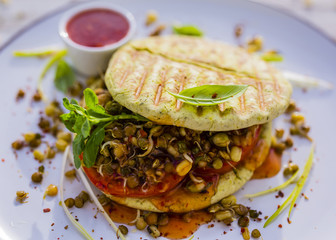 Herbal pita breads with tomato and fresh sprouts. Vegetarian food and healthy diet.