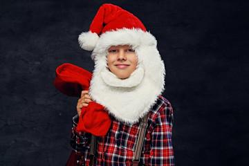 Teenage boy dressed in Santa's holiday costume.