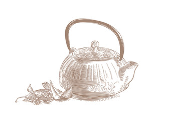 Iron teapot with tea leaves