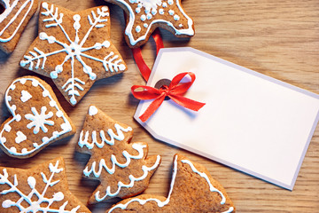 Greeting card with gingerbread cookies. Close up, top view. Merry Christmas and Happy New Year!!