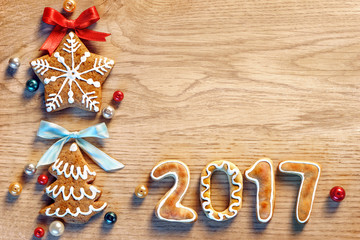 Gingerbread cookies on wooden table. Close up, top view. Merry Christmas and Happy New Year 2017!