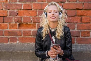 Woman enjoying peacefull music on her headphones