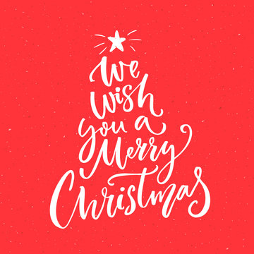 We wish you a Merry Christmas text. Calligraphy text for greeting cards on red background
