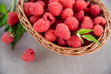 Fresh summer raspberry in a basket. Selective focus.