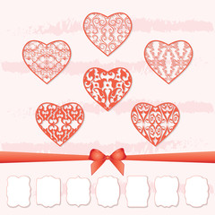 A set of hearts and a collection of frames of different shapes by cutting out paper.