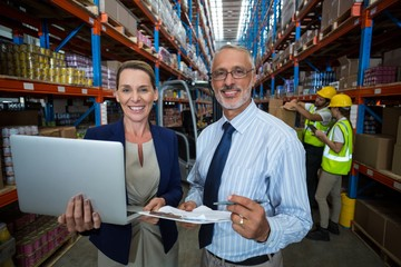 Warehouse manager and client with digital tablet