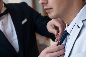 groom fixes tie best man